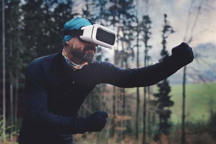 An adult man in VR action